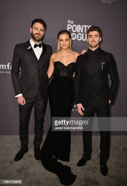 Alex Pall Kelsea Ballerini and Andrew Taggart of The Chainsmokers attend the amfAR New York Gala 2019 at Cipriani Wall Street on February 6 2019 in...