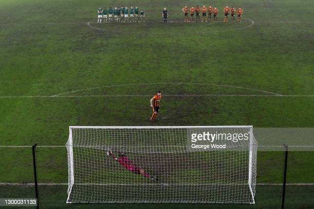 Alex Palmer of Lincoln City saves a penalty taken by Jordan Flores of Hull City to win the penalty shoot out in the Papa John's Trophy match between...