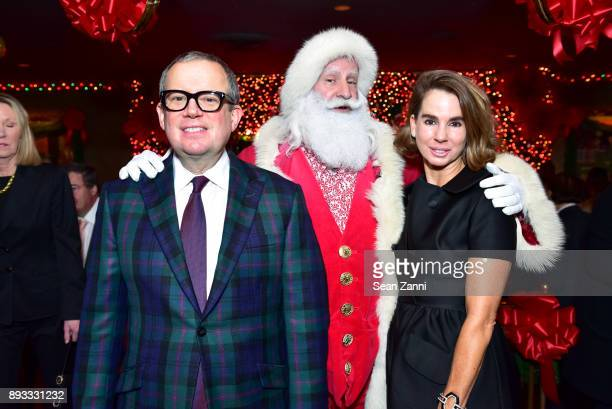 Alex Papachristidis Santa Claus and Fruzsina Keehn attend A Christmas Cheer Holiday Party 2017 Hosted by George Farias and Anne and Jay McInerney at...