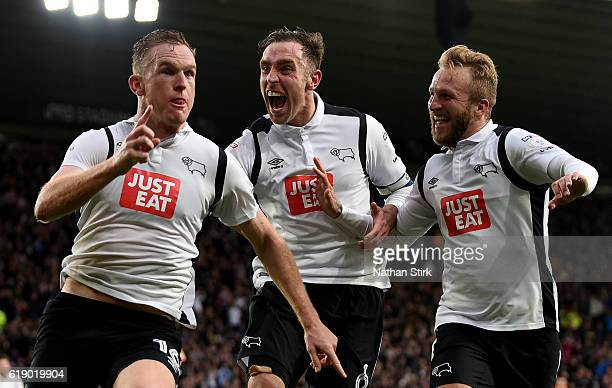 Alex Pearce of Derby County celebrates with Richard Keogh and Johnny Russell after scoring the second goal during the Sky Bet Championship match...