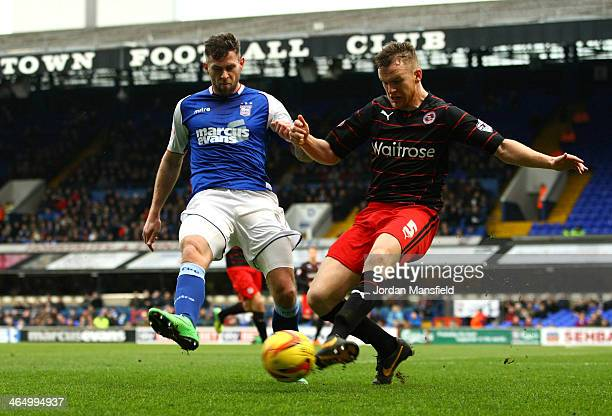 Alex Pearce of Reading FC battles for possesion with Daryl Murphy of Ipswich Town during the Sky Bet Championship match between Ipswich Town and...