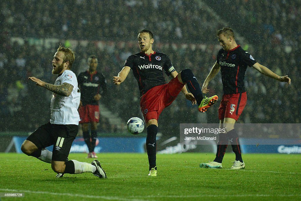 Alex Pearce of Reading scores an own goal during the Capital One Cup Third Round match between Derby County and Reading at Pride Park Stadium on September 23, 2014 in Derby, England.