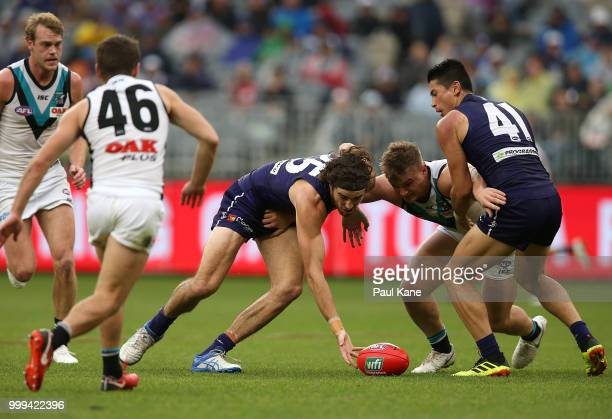 Alex Pearce of the Dockers and Ollie Wines of the Power contest for the ball during the round 17 AFL match between the Fremantle Dockers and the Port...