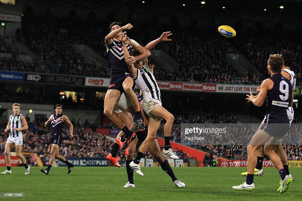 Alex Pearce of the Dockers spoils the mark for Adam Oxley of the Magpies during the round 13 AFL match between the Fremantle Dockers and the Collingwood Magpies at Domain Stadium on June 25, 2015 in Perth, Australia.