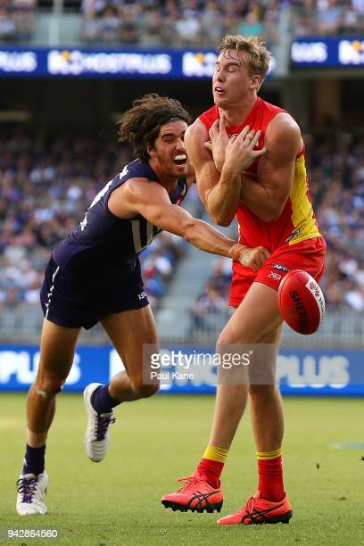 Alex Pearce of the Dockers spoils the mark for Tom Lynch of the Suns during the round three AFL match between the Gold Coast Suns and the Fremantle...