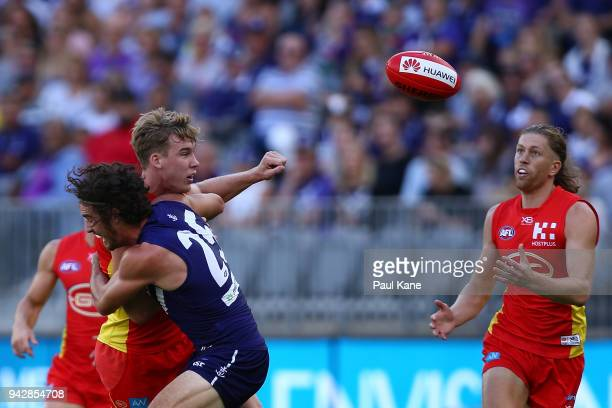 Alex Pearce of the Dockers tackles Tom Lynch of the Suns during the round three AFL match between the Gold Coast Suns and the Fremantle Dockers at...