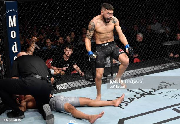 Alex Perez celebrates after his submission victory over Jordan Espinosa in their flyweight fight during the UFC Fight Night event at PNC Arena on...