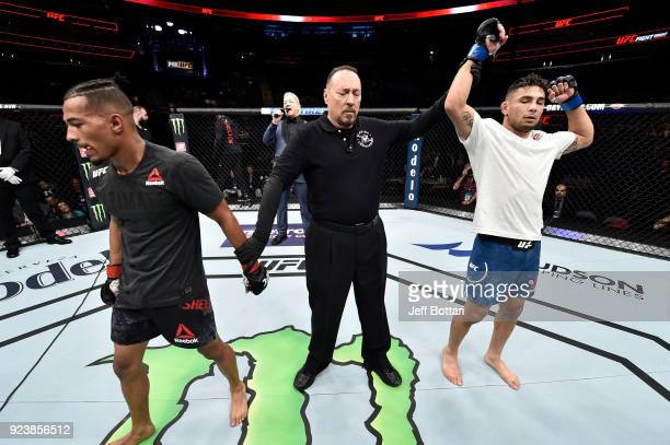 Alex Perez celebrates after his victory over Eric Shelton in their flyweight bout during the UFC Fight Night event at Amway Center on February 24...