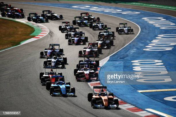 Alex Peroni of Australia and Campos Racing leads Matteo Nannini of Italy and Jenzer Motorsport and the rest of the field at the start during race two...