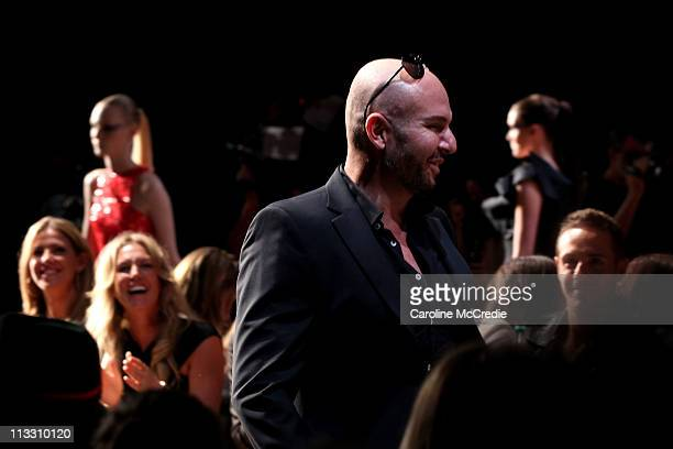 Alex Perry walks the catwalk after his show during Rosemount Australian Fashion Week Spring/Summer 2011/12 at Overseas Passenger Terminal on May 2...