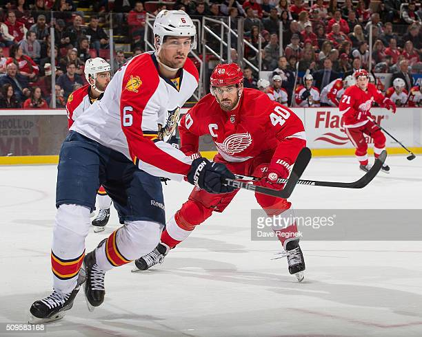 Alex Petrovic of the Florida Panthers and Henrik Zetterberg of the Detroit Red Wings follows the play during an NHL game at Joe Louis Arena on...