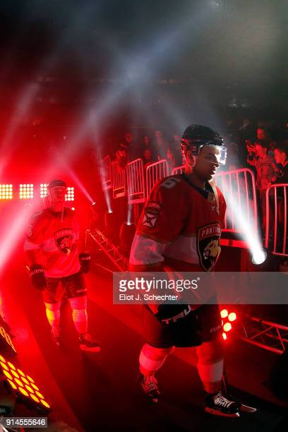 Alex Petrovic of the Florida Panthers and teammates head out to the ice for introductions prior to the start of their game against the Detroit Red...