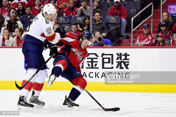Alex Petrovic of the Florida Panthers and TJ Oshie of the Washington Capitals battle for the puck in the first period during a NHL game at Verizon...