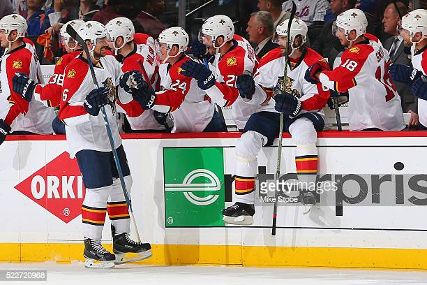 Alex Petrovic of the Florida Panthers celebrates his third period goal with Jaromir Jagr against the New York Islanders in Game Four of the Eastern...