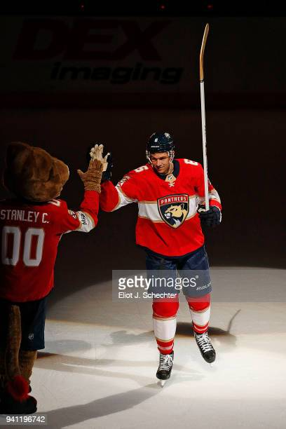 Alex Petrovic of the Florida Panthers celebrates their 32 win over the Carolina Hurricanes at the BBT Center on April 2 2018 in Sunrise Florida