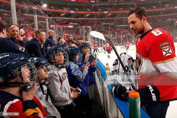 Alex Petrovic of the Florida Panthers chats with young hockey fans during warm ups prior to the start of the game against the Pittsburgh Penguins at...
