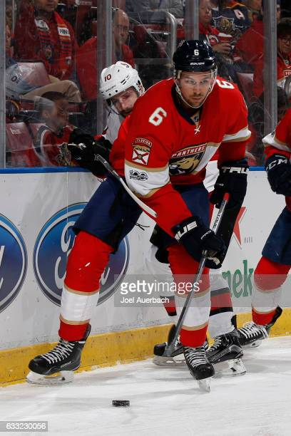 Alex Petrovic of the Florida Panthers chess the puck away from Tom Pyatt of the Ottawa Senators during second period action at the BBT Center on...