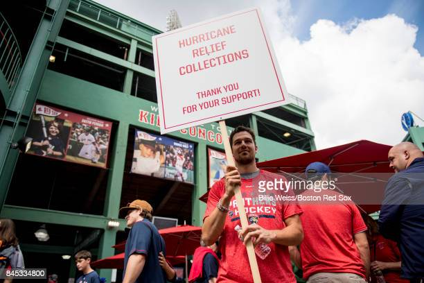 Alex Petrovic of the Florida Panthers collects money at the gates for Hurricane Irma relief before a game between the Boston Red Sox and the Tampa...