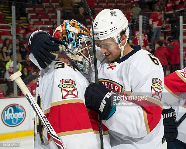 Alex Petrovic of the Florida Panthers congratulates teammate James Reimer for the victory after an NHL game against the Detroit Red Wings at Joe...