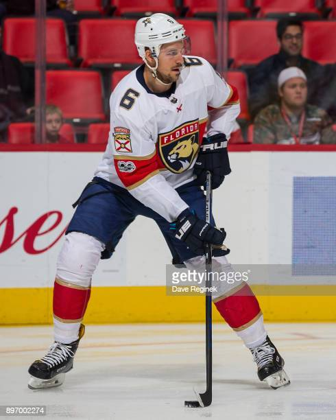 Alex Petrovic of the Florida Panthers controls the puck against the Detroit Red Wings during an NHL game at Little Caesars Arena on December 11 2017...