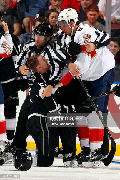 Alex Petrovic of the Florida Panthers fights with Trevor Lewis of the Los Angeles Kings at the BBT Center on February 9 2017 in Sunrise Florida