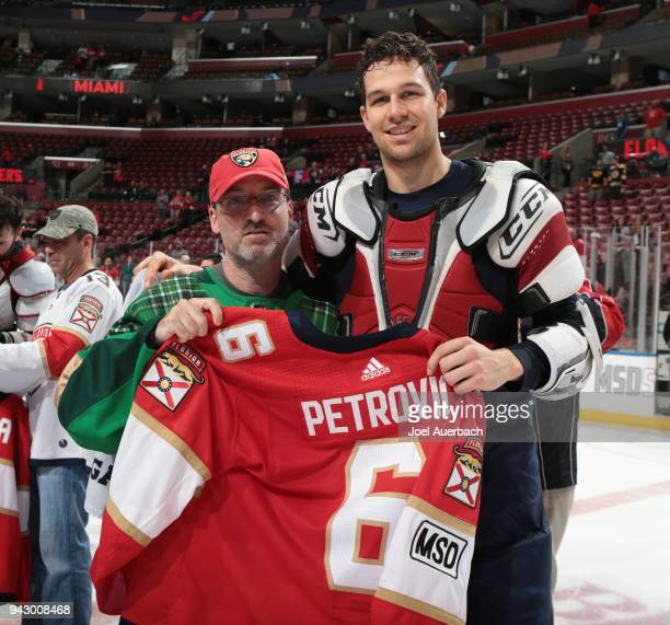 Alex Petrovic of the Florida Panthers gives his jersey to fan during the 'shirts off our back' promotion after the game against the Boston Bruins at...