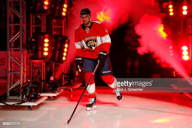 Alex Petrovic of the Florida Panthers heads out to the ice during opening festivities prior to the start of the game against the Tampa Bay Lightning...