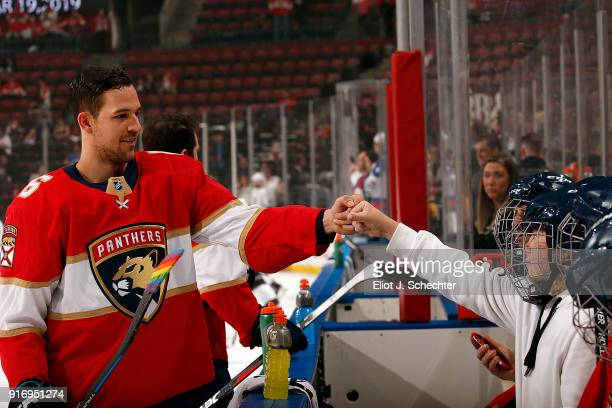 Alex Petrovic of the Florida Panthers knuckle bumps bench warmers during warm ups prior to the start of the game against the Los Angeles Kings at the...