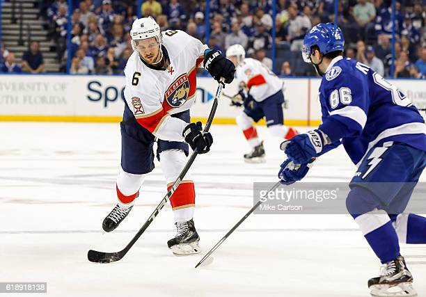 Alex Petrovic of the Florida Panthers shoots past Nikita Kucherov of the Tampa Bay Lightning during the third period at the Amalie Arena on October...