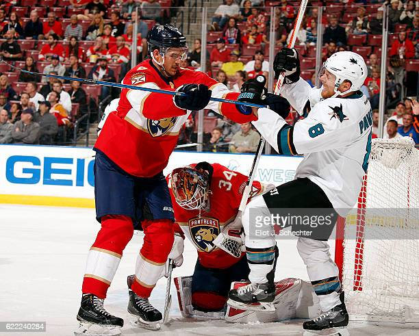 Alex Petrovic of the Florida Panthers shoves Joe Pavelski of the San Jose Sharks at the BBT Center on November 10 2016 in Sunrise Florida