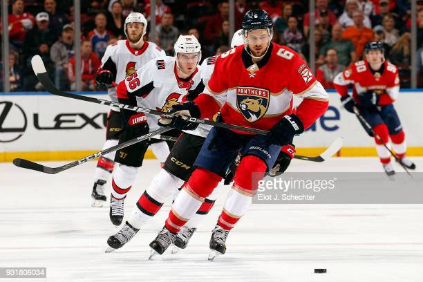 Alex Petrovic of the Florida Panthers skates for possession against the Ottawa Senators at the BBT Center on March 12 2018 in Sunrise Florida