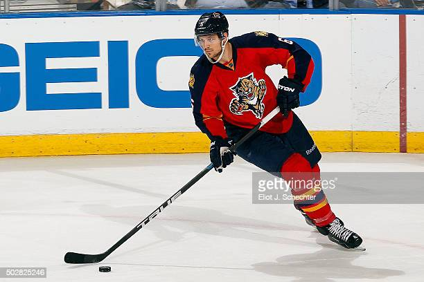Alex Petrovic of the Florida Panthers skates with the puck against the Ottawa Senators at the BBT Center on December 22 2015 in Sunrise Florida
