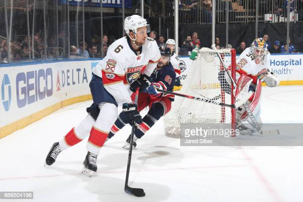 Alex Petrovic of the Florida Panthers skates with the puck against Rick Nash of the New York Rangers at Madison Square Garden on March 17 2017 in New...