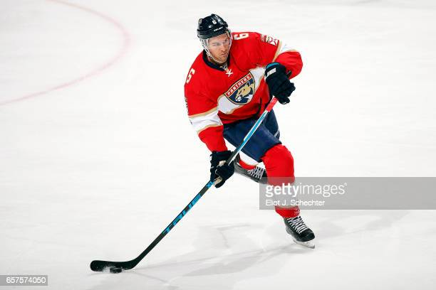 Alex Petrovic of the Florida Panthers skates with the puck against the Arizona Coyotes at the BBT Center on March 23 2017 in Sunrise Florida