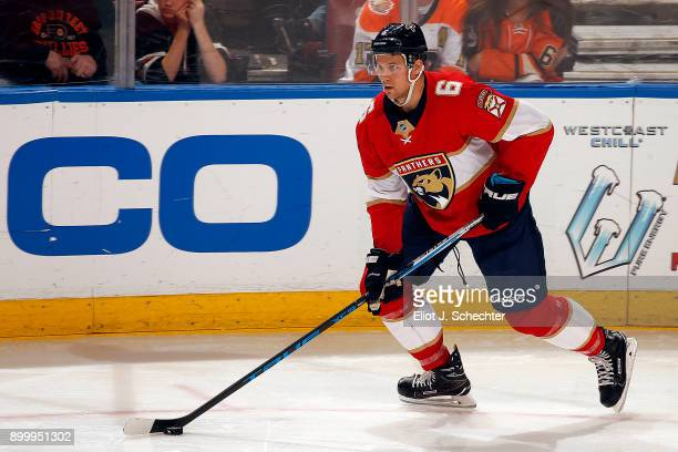 Alex Petrovic of the Florida Panthers skates with the puck against the Philadelphia Flyers at the BBT Center on December 28 2017 in Sunrise Florida