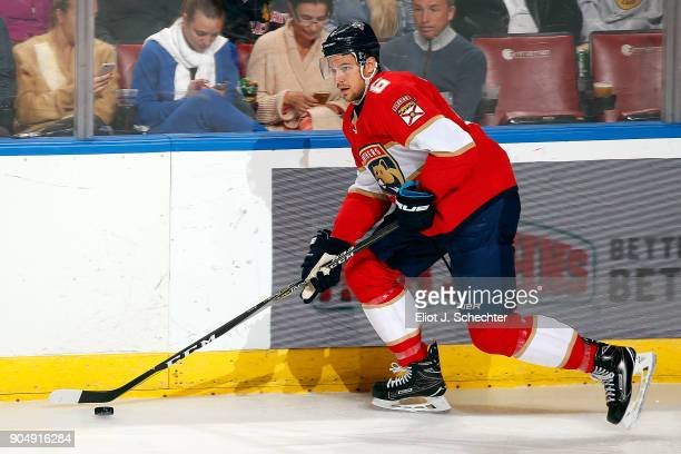 Alex Petrovic of the Florida Panthers skates with the puck against the Calgary Flames at the BBT Center on January 12 2018 in Sunrise Florida