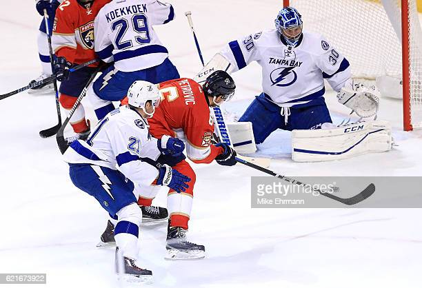 Alex Petrovic of the Florida Panthers takes a shot on Ben Bishop of the Tampa Bay Lightning during a game at BBT Center on November 7 2016 in Sunrise...