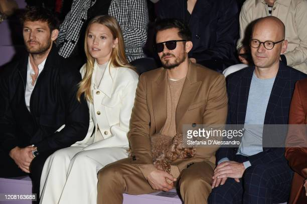 Alex Pettyfer Toni Garrn Orlando Bloom and Mark Langer attend the Boss fashion show on February 23 2020 in Milan Italy