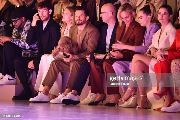 Alex Pettyfer Toni Garrn Orlando Bloom with his dog Mighty Mark Langer Amber Valletta Cara Delevingne and Ashley Benson attend the Boss fashion show...