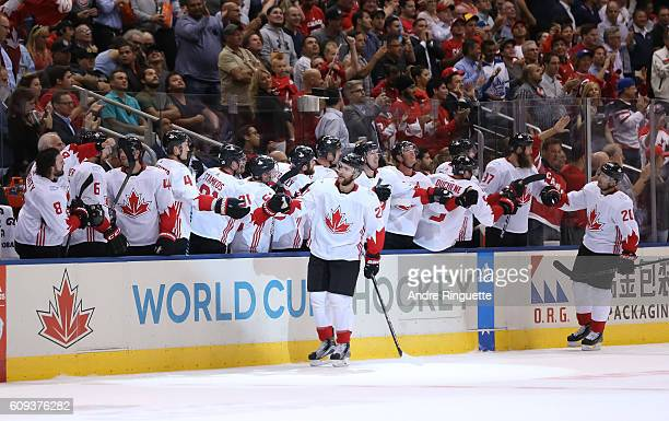 Alex Pietrangelo and John Tavares of Team Canada high fives the bench after a second period goal against Team USA during the World Cup of Hockey 2016...