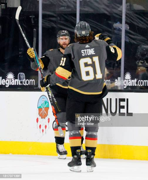 Alex Pietrangelo and Mark Stone of the Vegas Golden Knights celebrate after Stone assisted Pietrangelo on a first-period goal against the Colorado...