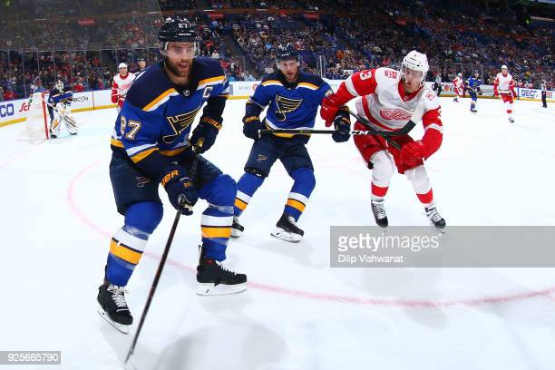 Alex Pietrangelo and Vladimir Sobotka of the St Louis Blues race Nick Jensen of the Detroit Red Wings to the puck at Scottrade Center on February 28...