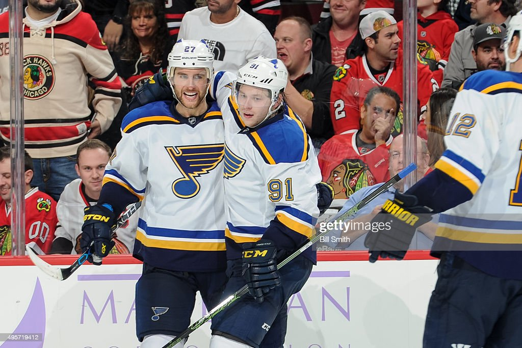 Alex Pietrangelo #27 and Vladimir Tarasenko #91 of the St. Louis Blues celebrate after Tarasenko scored the winning goal in overtime of the NHL game against the Chicago Blackhawks at the United Center on November 4, 2015 in Chicago, Illinois.