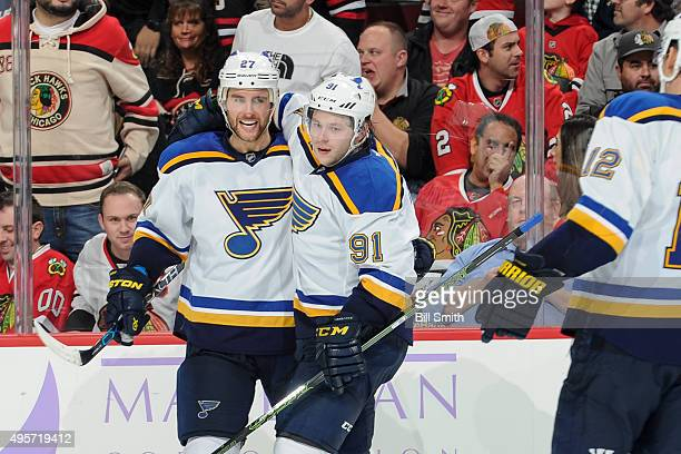 Alex Pietrangelo and Vladimir Tarasenko of the St Louis Blues celebrate after Tarasenko scored the winning goal in overtime of the NHL game against...