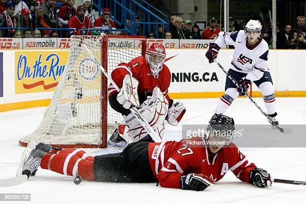 Alex Pietrangelo of Team Canada blocks a pass to Matt Donovan of Team USA in front of Jake Allen during the 2010 IIHF World Junior Championship...