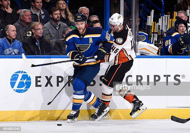 Alex Pietrangelo of the St Louis Blues and Jiri Sekac of the Anaheim Ducks battle for the puck on October 29 2015 at Scottrade Center in St Louis...