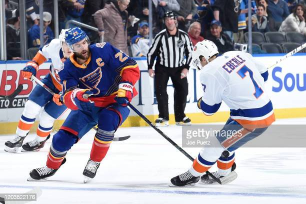 Alex Pietrangelo of the St Louis Blues and Jordan Eberle of the New York Islanders look for control of the puck at Enterprise Center on February 27...