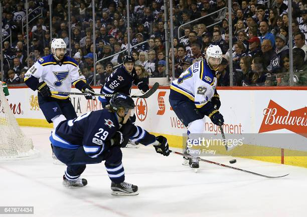 Alex Pietrangelo of the St Louis Blues backhands the puck over the stick of Patrik Laine of the Winnipeg Jets during third period action at the MTS...