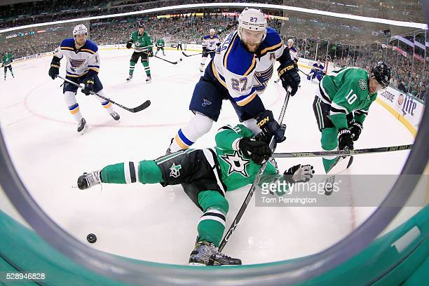 Alex Pietrangelo of the St Louis Blues battles for control of the puck against Cody Eakin of the Dallas Stars and Patrick Sharp of the Dallas Stars...