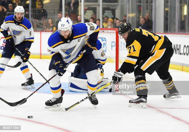 Alex Pietrangelo of the St Louis Blues battles for the puck against Evgeni Malkin of the Pittsburgh Penguins at UPMC Lemieux Sports Complex on...